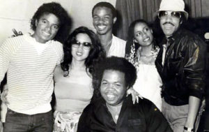 Pictured L to R behind Reggie Dozier: Michael Jackson, Susie Akita, unknown, Brenda Richie, and Lionel Richie